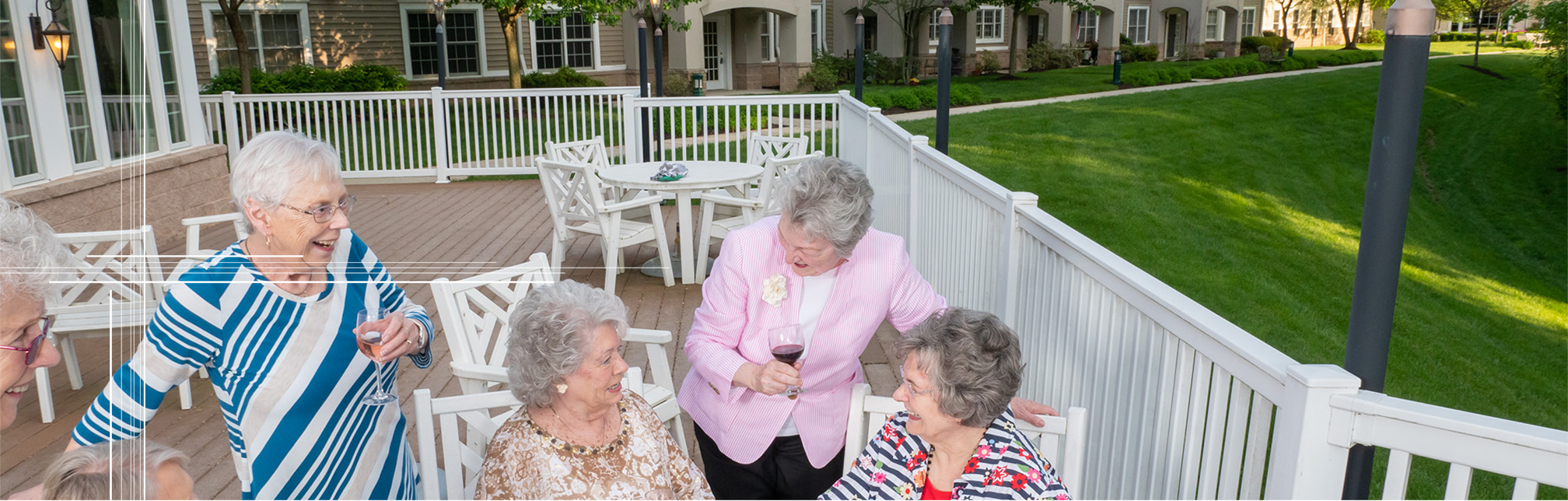Older ladies enjoying a glass of wine at our senior living community.