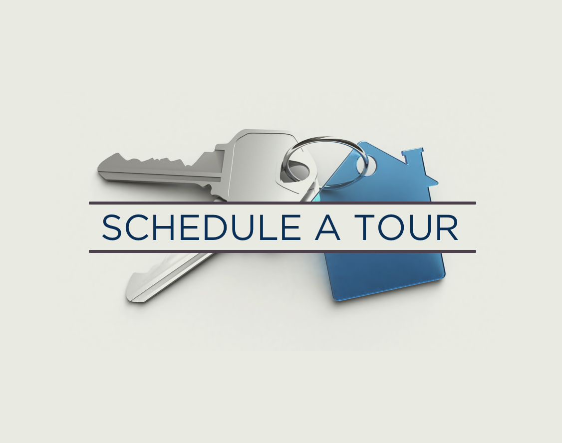An image of key that states Schedule a Tour.