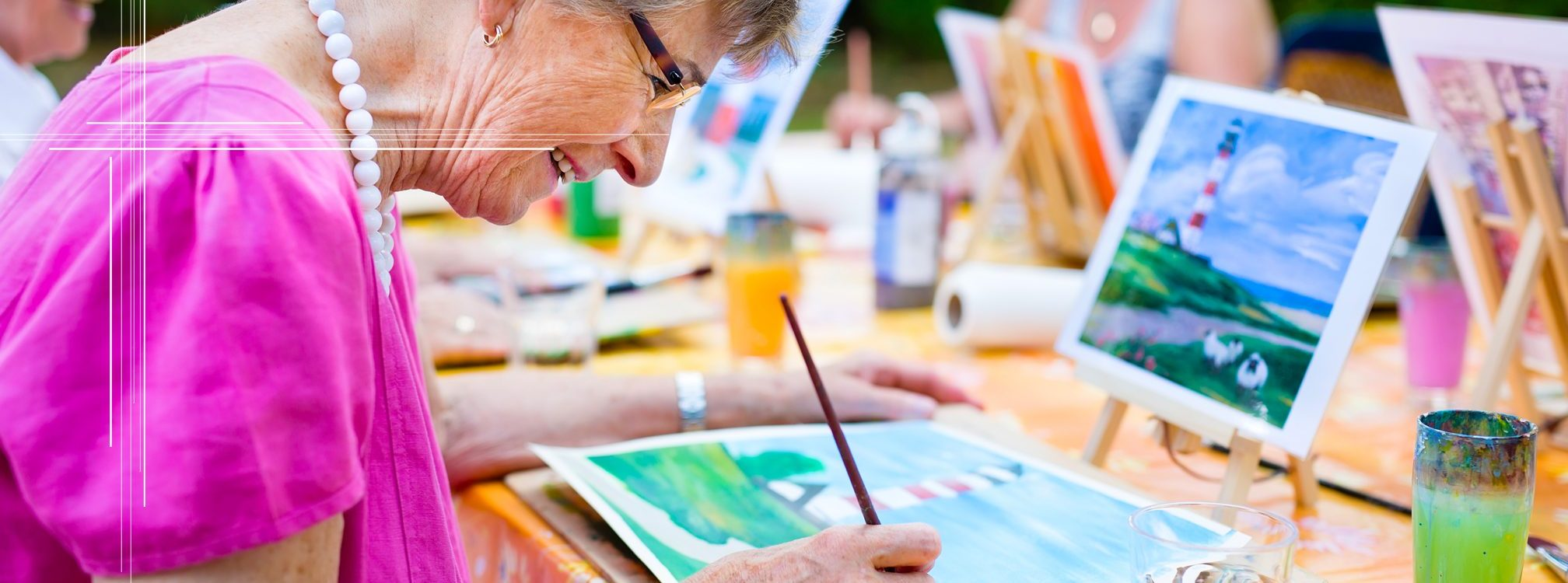 Woman painting a landscape scene at an assisted living facility.