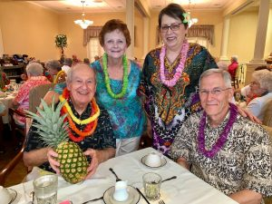 Group of seniors at a social luau.