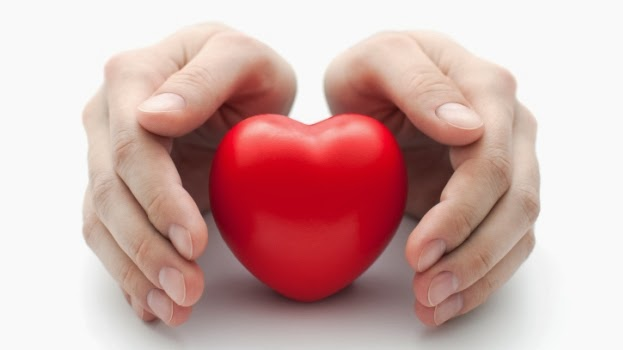 Two hands cupping a heart shaped stress ball.