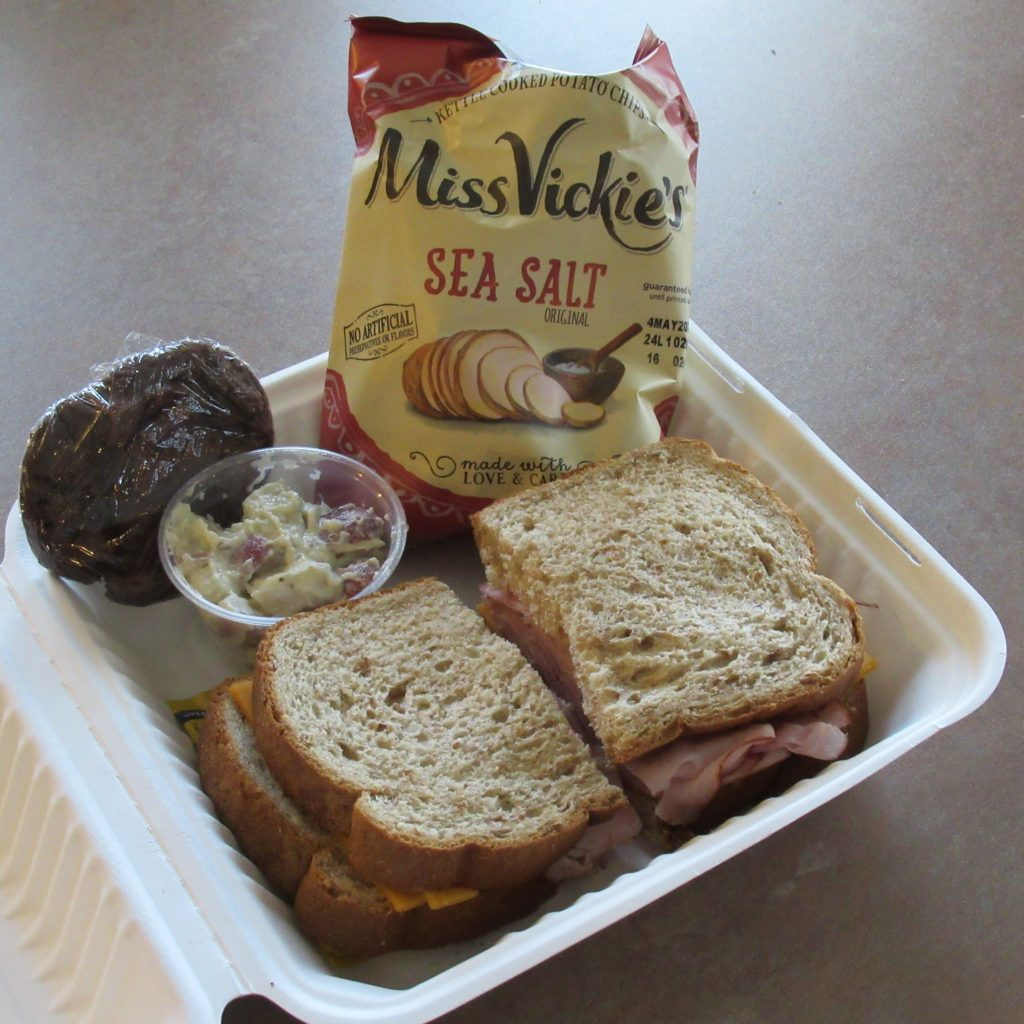 Ham and cheese sandwich, potato salad, chocolate chocolate chip cookie and chips from Blue Bistro Catering.