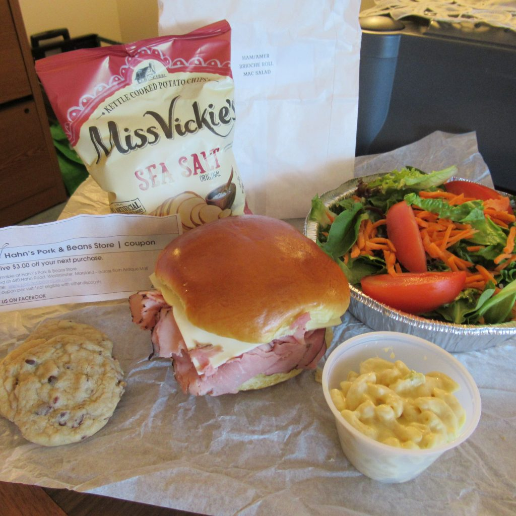 Ham and cheese sandwich, chocolate chip bacon cookies, macaroni salad, green tossed salad and a bag of potato chips from Hahn's.