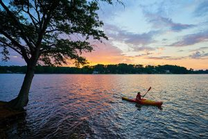 Kayaker getting the most out of senior living in Owings Mills at the local lakes.