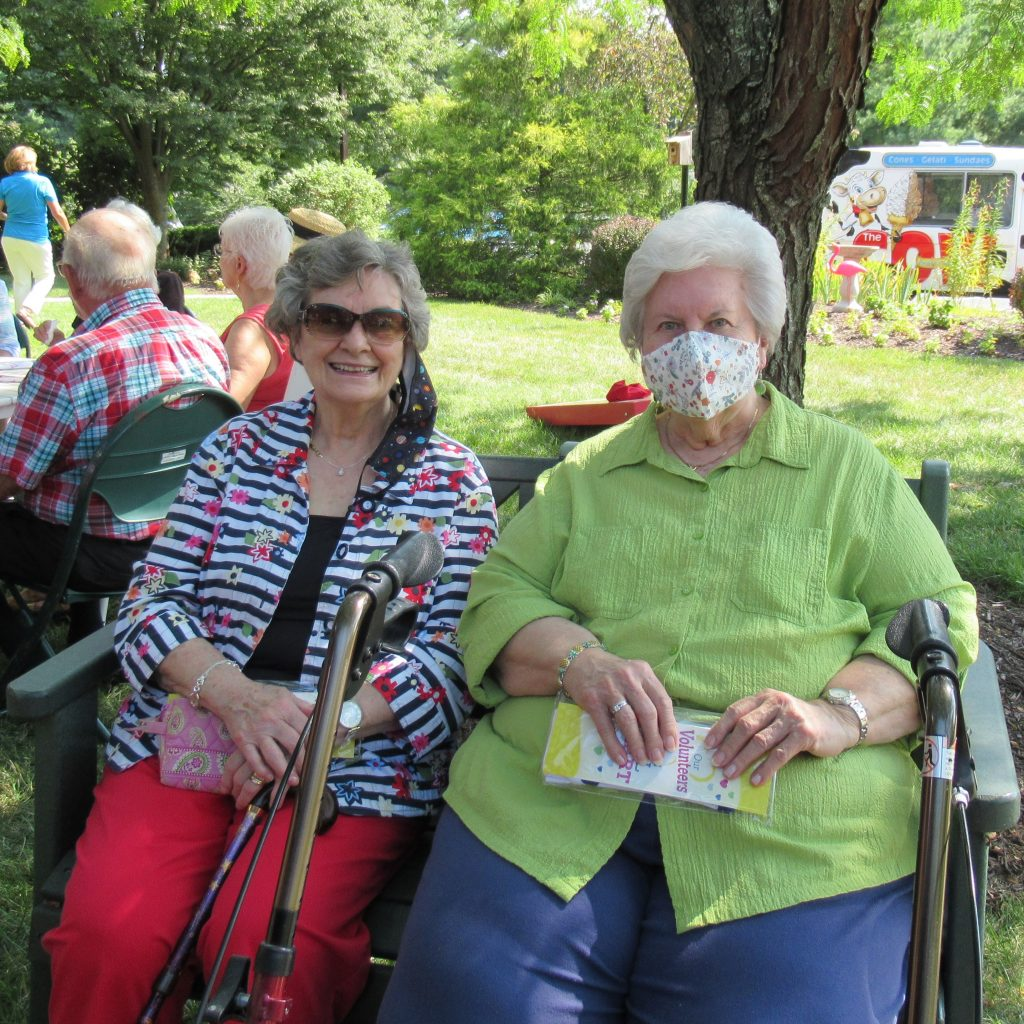 Two happy female residents enjoying their time at the volunteer appreciation event.