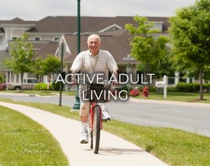 A man riding a bike in Carroll Lutheran Village with active adult living text appearing on the image.