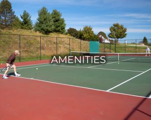An image of a man and woman playing tennis at Carroll Lutheran Village's tennis court with text that reads Amenities.